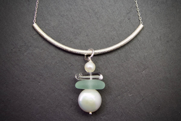 Necklace with curved bar and sea glass drop