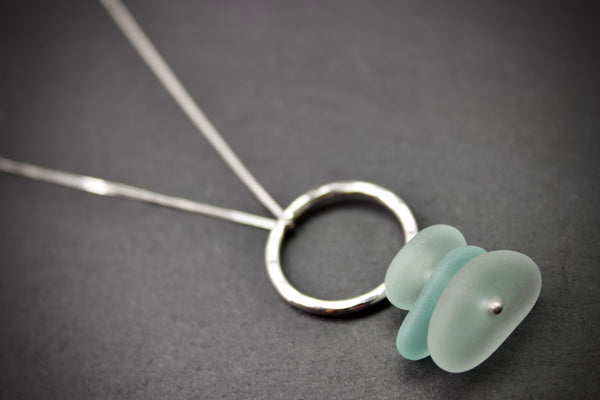 Pendant with hammered circle and stacked sea glass
