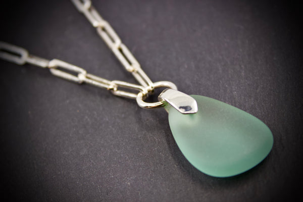 Necklace with sea glass pendant on silver square chain