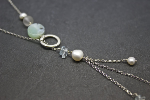 Pendant with chalcedony and three strand chains