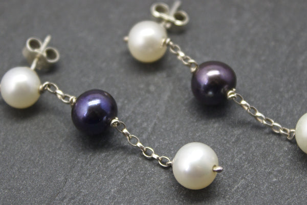 Earrings with three freshwater pearls