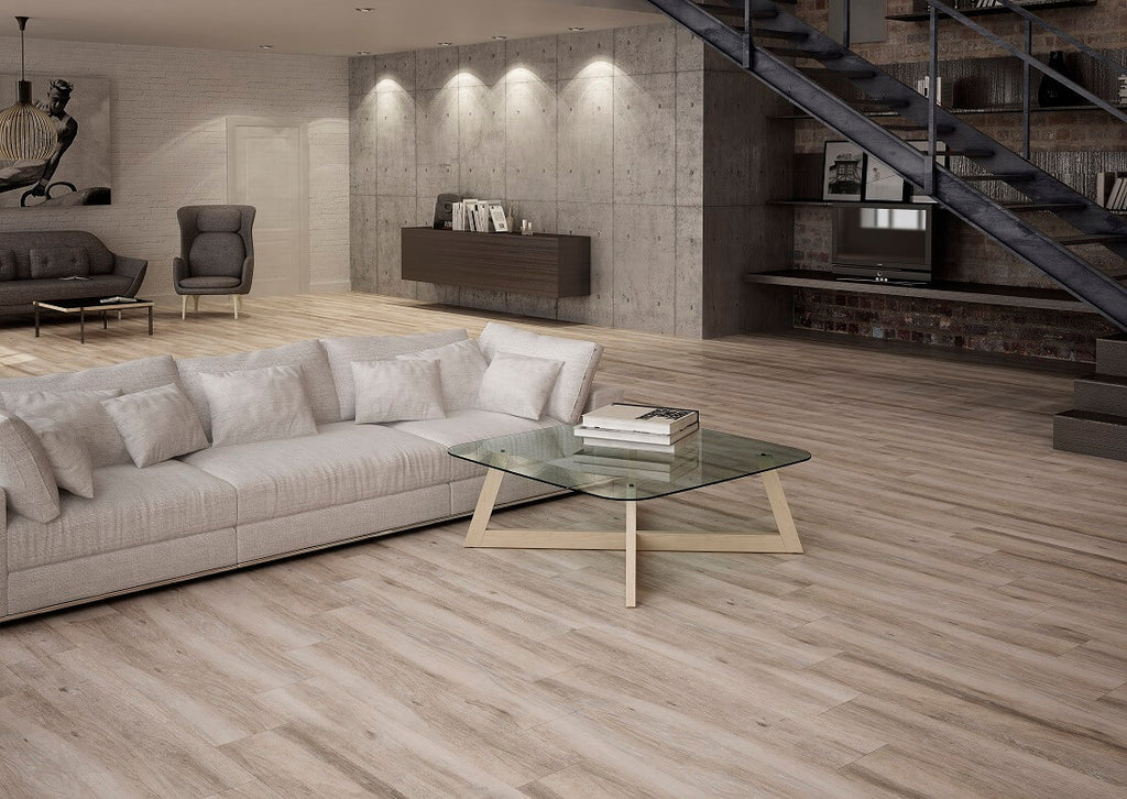 Atelier Taupe Wood Effect Tiles in Modern Living Room with Couches and Glass Coffee Table
