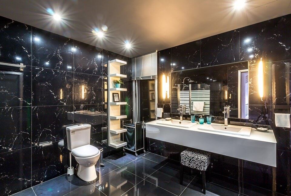 Beautiful Bathroom with Black Tiles and White Counter