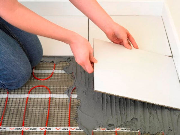 Installing bathroom tiles with underfloor heating