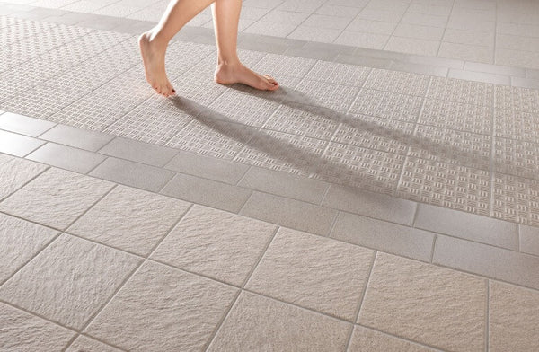 Bare Feet on Floor Tiles