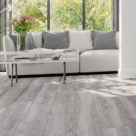 Atelier Grey Wood Effect Floor Tiles and Couch in Beautiful Home