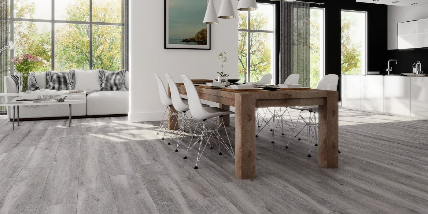 atelier grey wood effect floor tiles and dining room table in beautiful home by tile devil