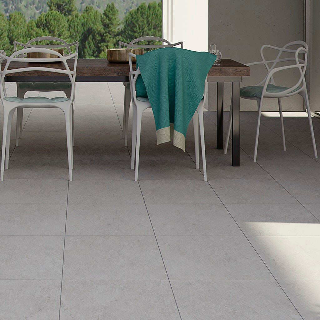 Grey floor tiles for a stunning patio or kitchen chicago large grey gris floor tiles on stylish patio with table and chairs dailygadgetfo Images