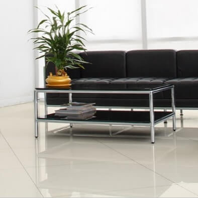 Harley Rectified White Polished Porcelain Floor Tiles with Black Couch and Coffee Table