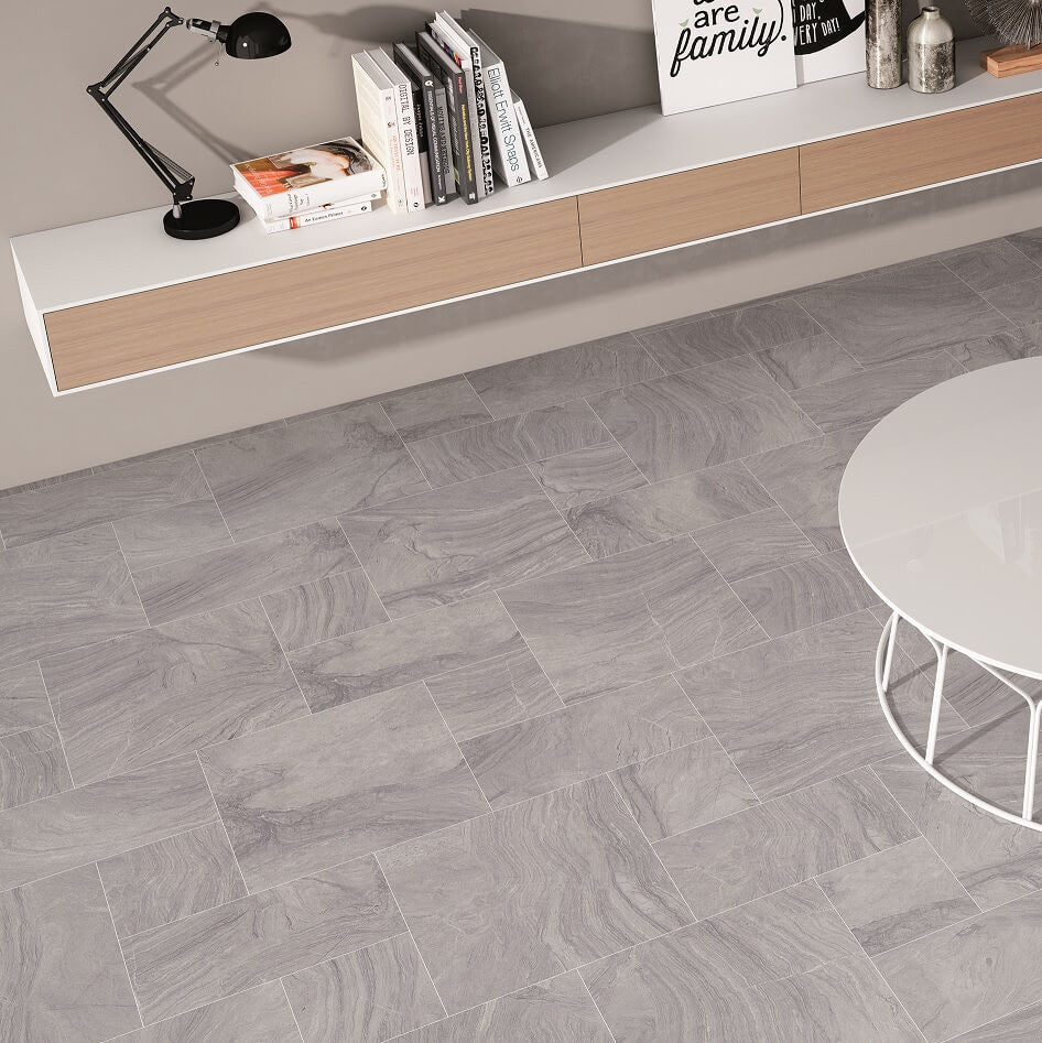 Sandstone effect grey spanish floor tiles by gayafores varana grey floor tiles in mixed sizes with book shelf dailygadgetfo Images