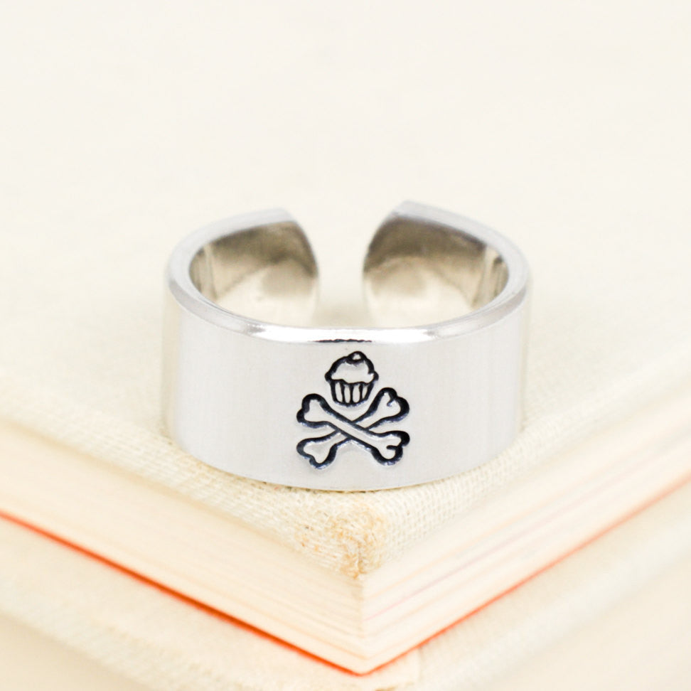 Cupcake and Crossbones Ring - Bake or Die - Adjustable Aluminum Ring - It Came From the Internet