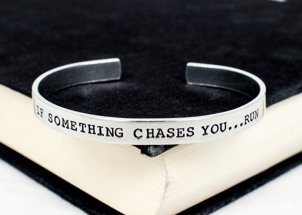 If Something Chases You... Run - Jurassic World - Adjustable Aluminum Cuff Bracelet - It Came From the Internet