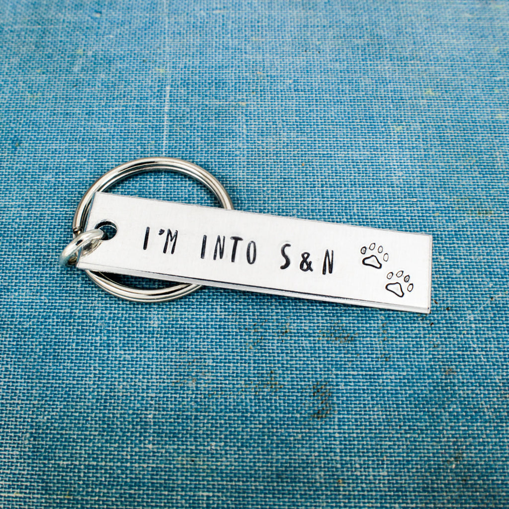 I'm into S&N - Spay and Neuter - Animal Rescue - Dog Rescue - Cat Rescue - Aluminum Key Chain - It Came From the Internet