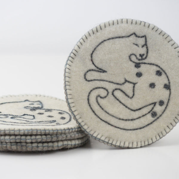 Snow Leopard Coasters – Set of 4