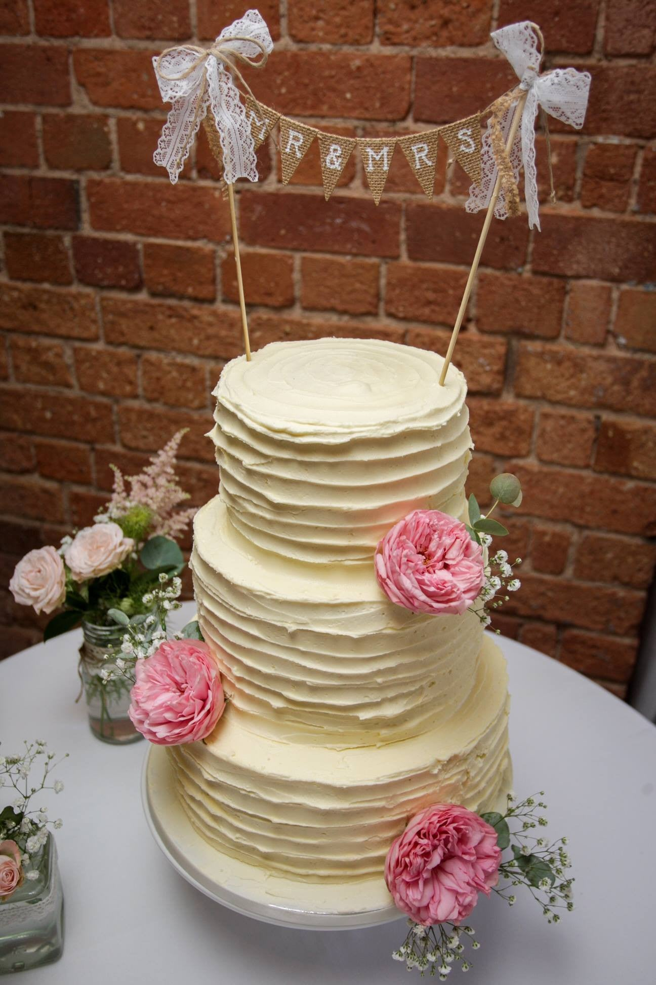 Natural style wedding cake with pink Peony decoration.