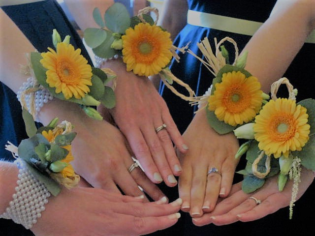 Wrist corsages with Sunflowers for a Summer Beach themed wedding.