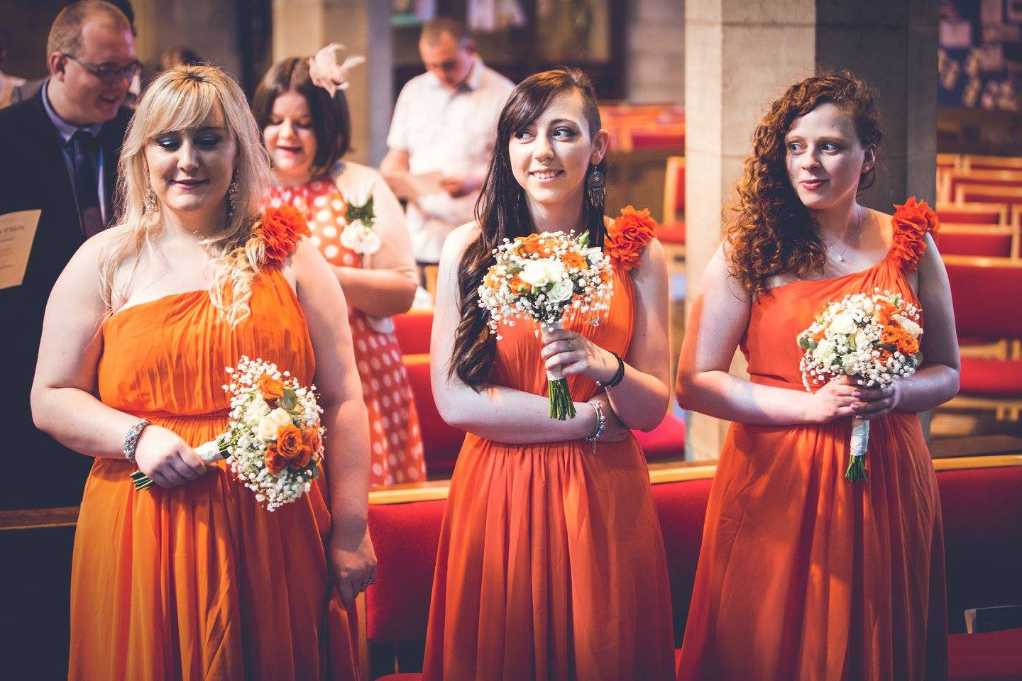 Bridesmaid's with white and orange Rose and Gypsophila bouquets.