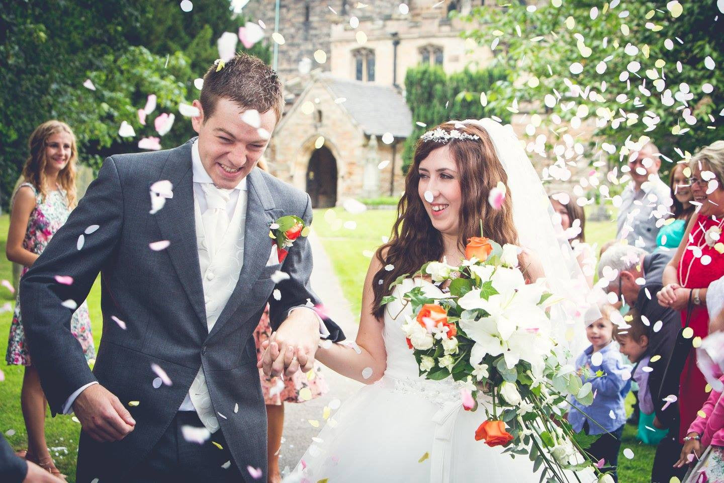 Bride and Groom with confetti and wedding flowers.