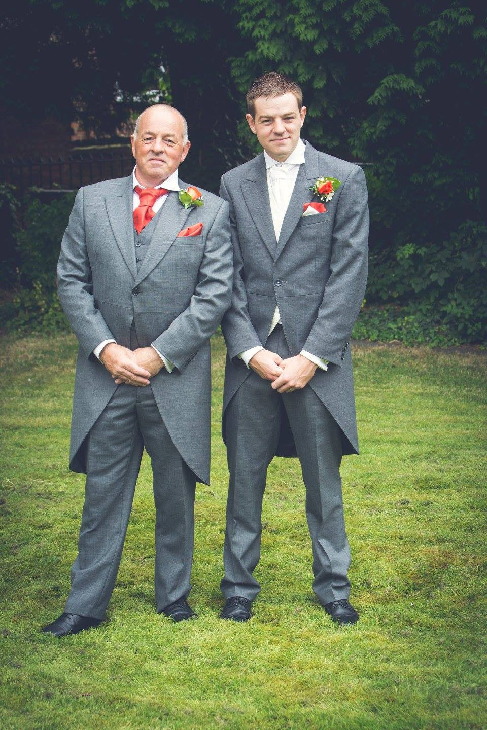 Father of the Groom and the Groom with orange Rose buttonholes.