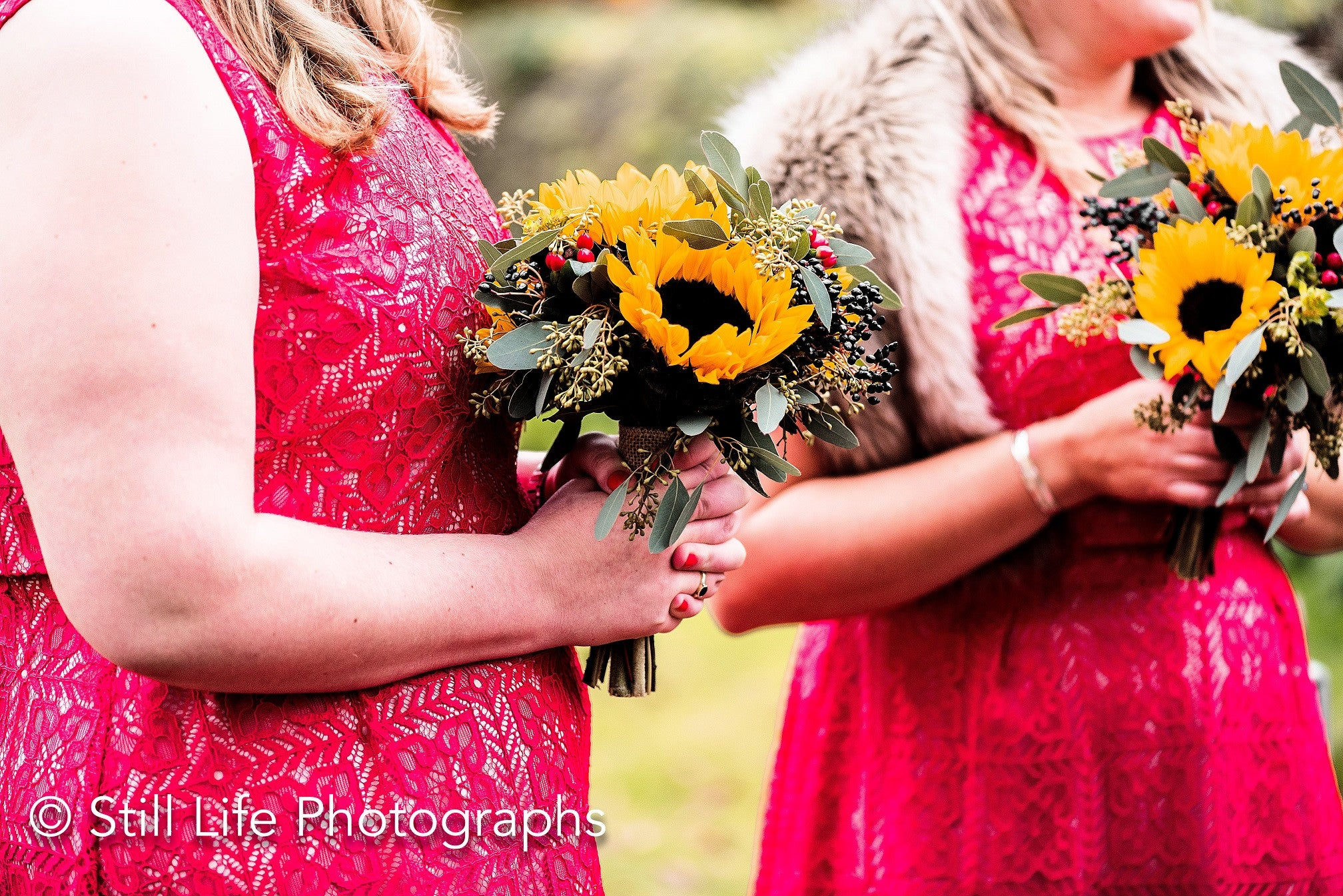 Bridesmaid's hand tied bouquets with Sunflowers and foliage.