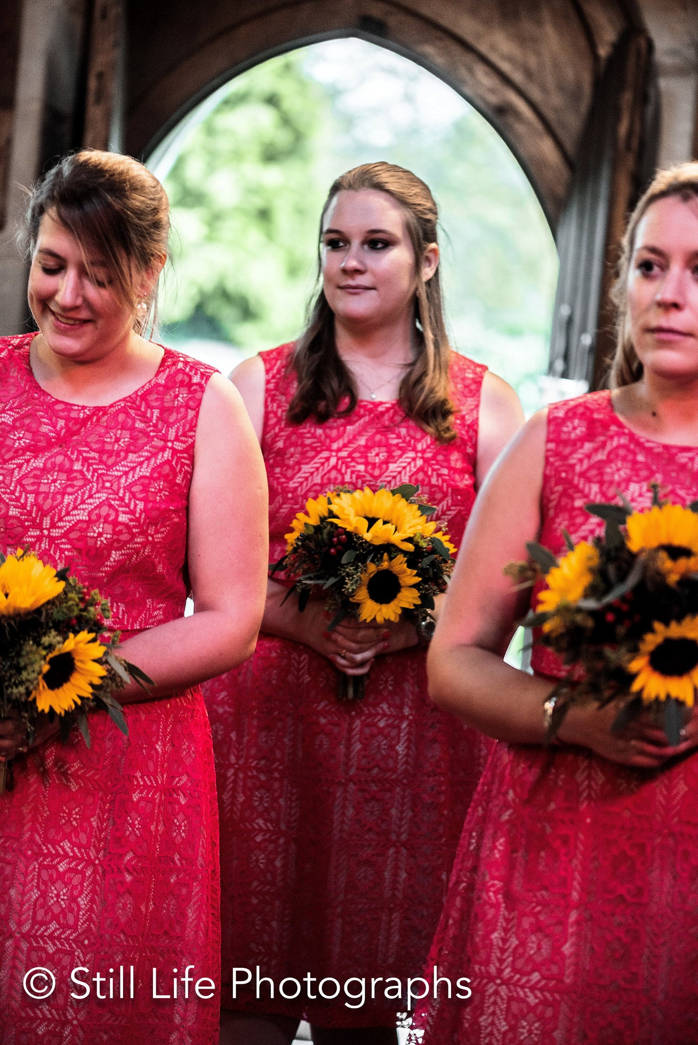 Bridesmaid's and bouquets with Sunflowers and Rosehip berries.