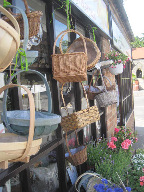 Outside of shop showcasing our basket and plant collections.