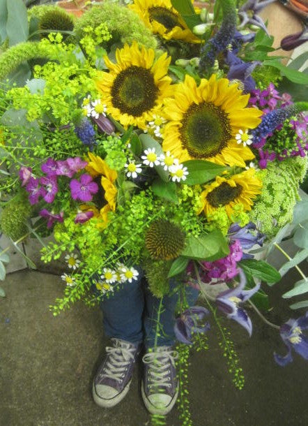 Bright sunflower and daisy bouquet for summer.