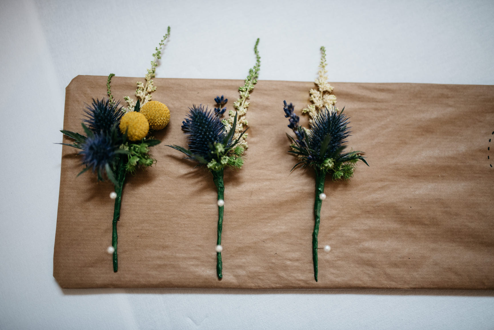Gents Wedding Buttonholes with Thistle and foliage