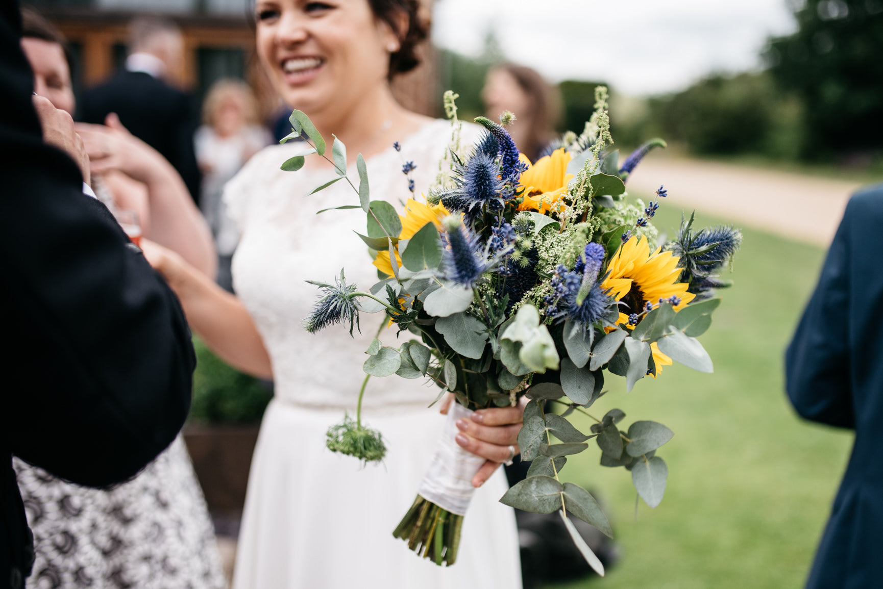 Bridal Bouquet with Sunflowers, Thistle and foliage