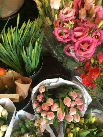 Selection of flowers in store including Tulips and Daffodils