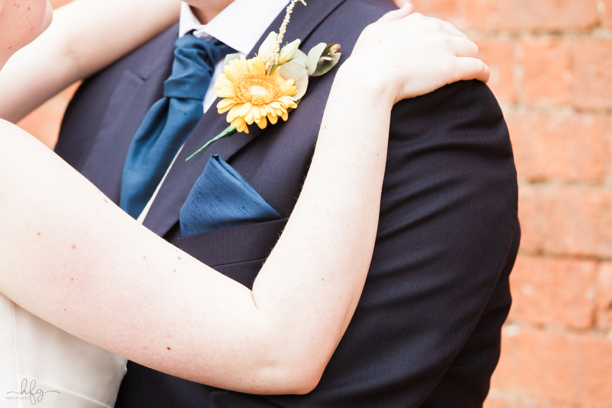 Groom's buttonhole with yellow Gerbera.