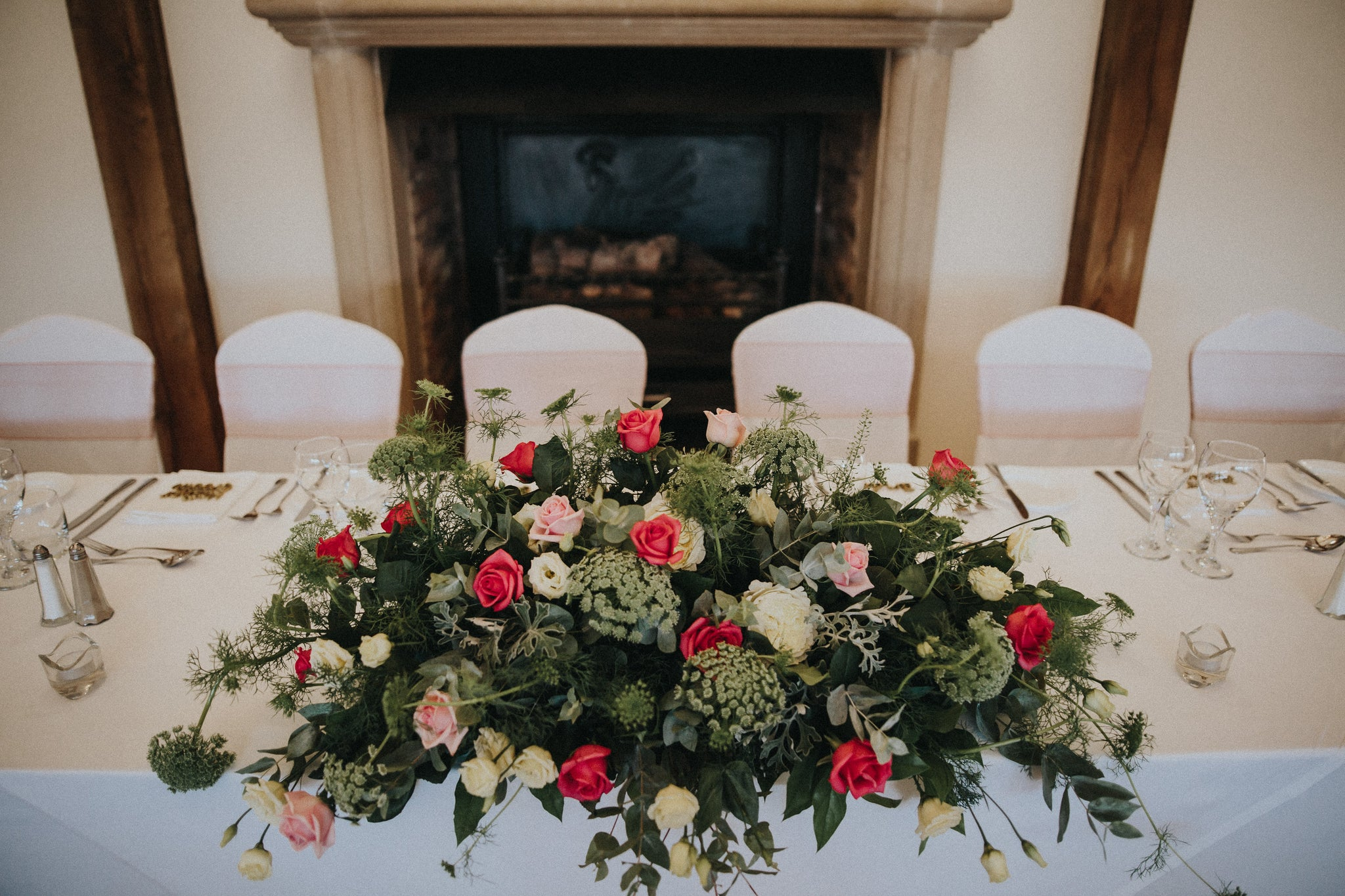 Pink and white Rose top table arrangement at Swancar Farm
