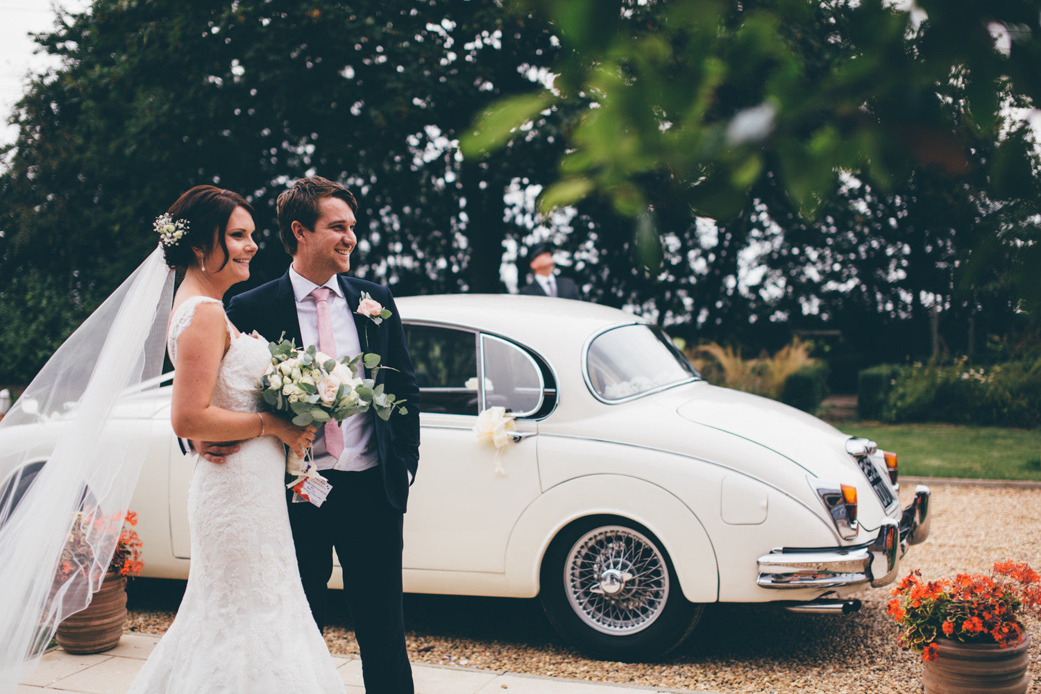 Bride and Groom with Rose and Gypsophila Wedding Flowers including Bouquet and Buttonholes