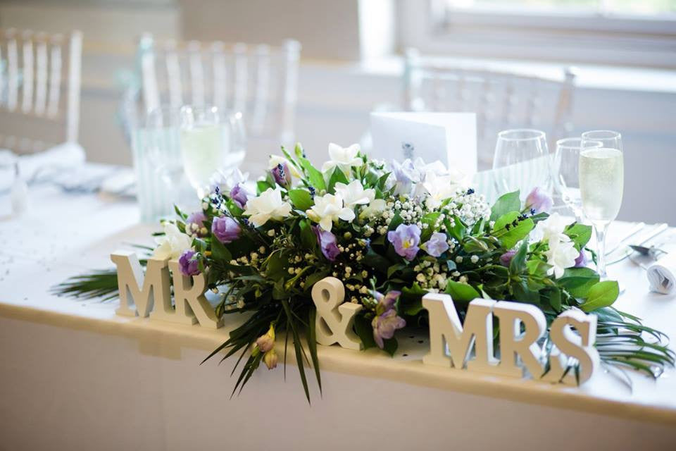 Wedding top table arrangement with white Freesia.