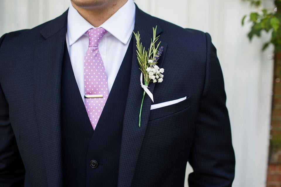 Groom's buttonhole with Rosemary and Gypsophila.