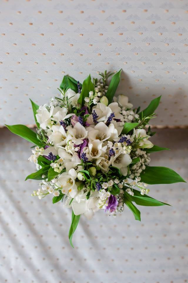 Bridal bouquet with white Freesia, Lily of the Valley, Lisianthus, Lavender and Rosemary with Gypsophila.