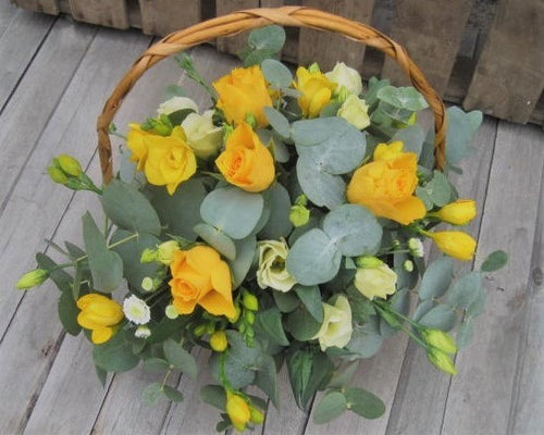 Basket arrangement with Roses, Lisianthus, Freesia and Eucalyptus foliage