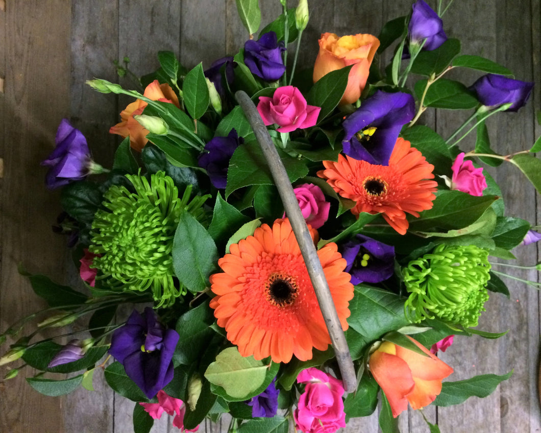 Vibrant basket arrangement with Gerberas, Lisianthus, Roses, Spray Roses and Chrysanthemum Blooms