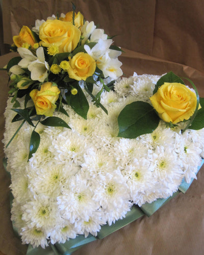Funeral Heart Arrangement with blocked in Flowers.