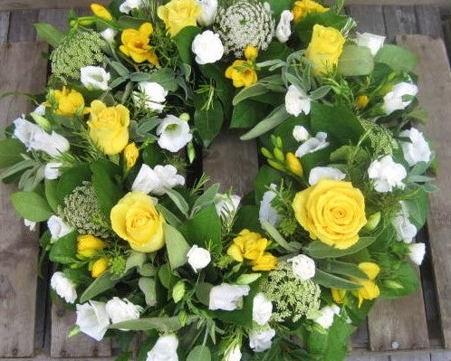 Yellow country style funeral wreath
