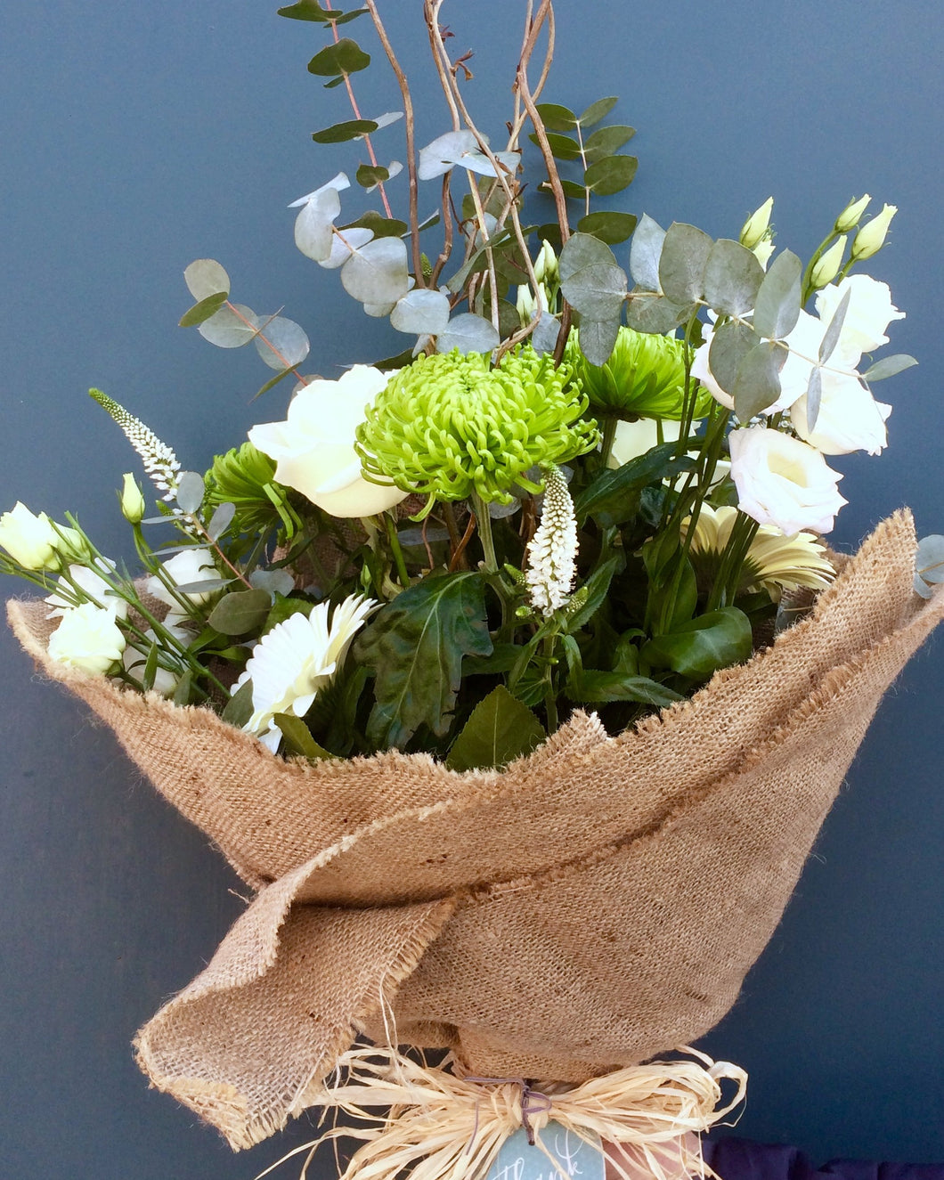 Eco friendly summer bouquet with roses and lisianthus