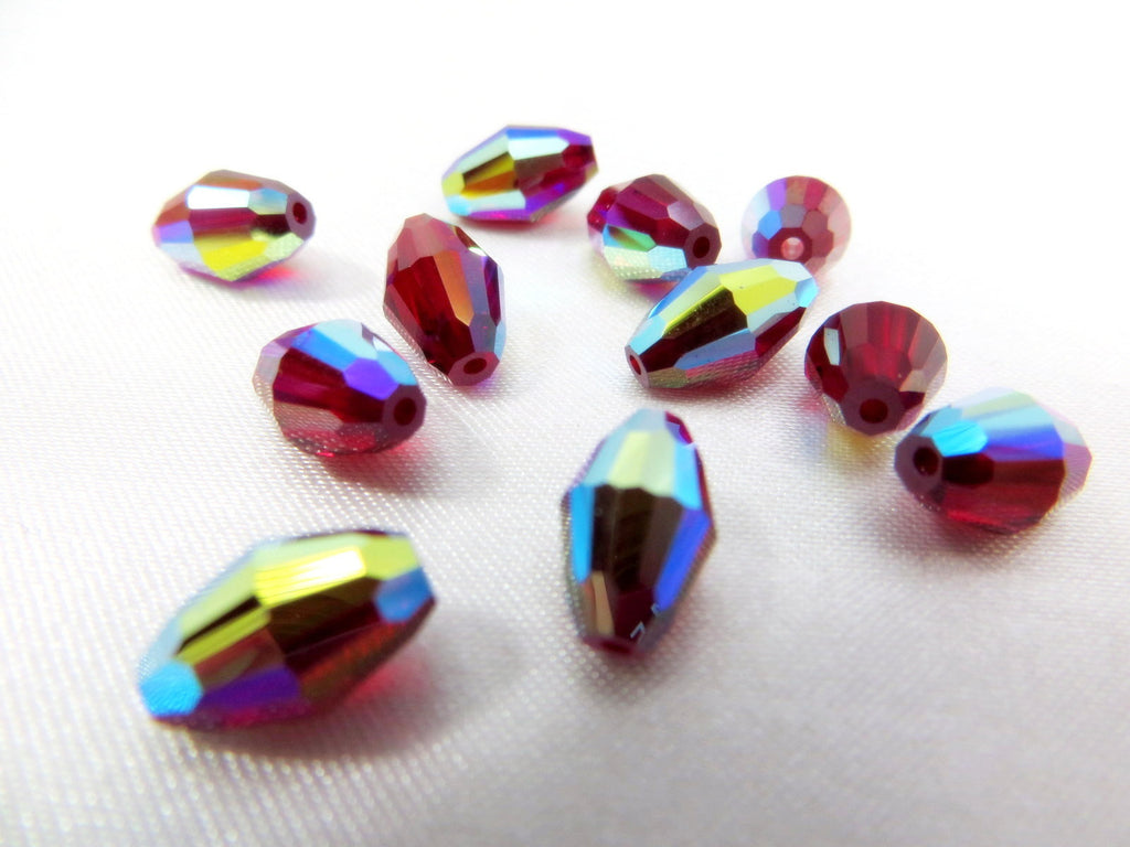 Red Siam AB Swarovski 9mm x 6mm Barrel Beads (6) - Odyssey Cache