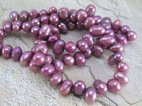 14.5 Inch Strand of Fuchsia Orchid Plum 7mm Cross Drilled Potato Freshwater Pearls - Odyssey Cache