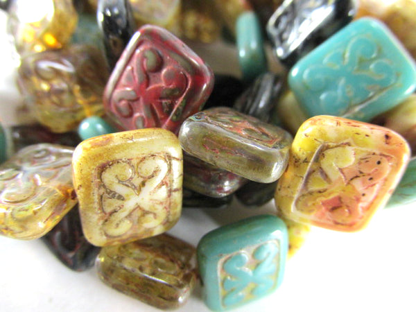 Czech Glass Carved Rectangles in Green Turquoise, Dark Red, Black, Gold and Beige (15) - Odyssey Cache