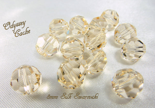 Silk Swarovski #5000 8mm faceted round beads (6) - Odyssey Cache