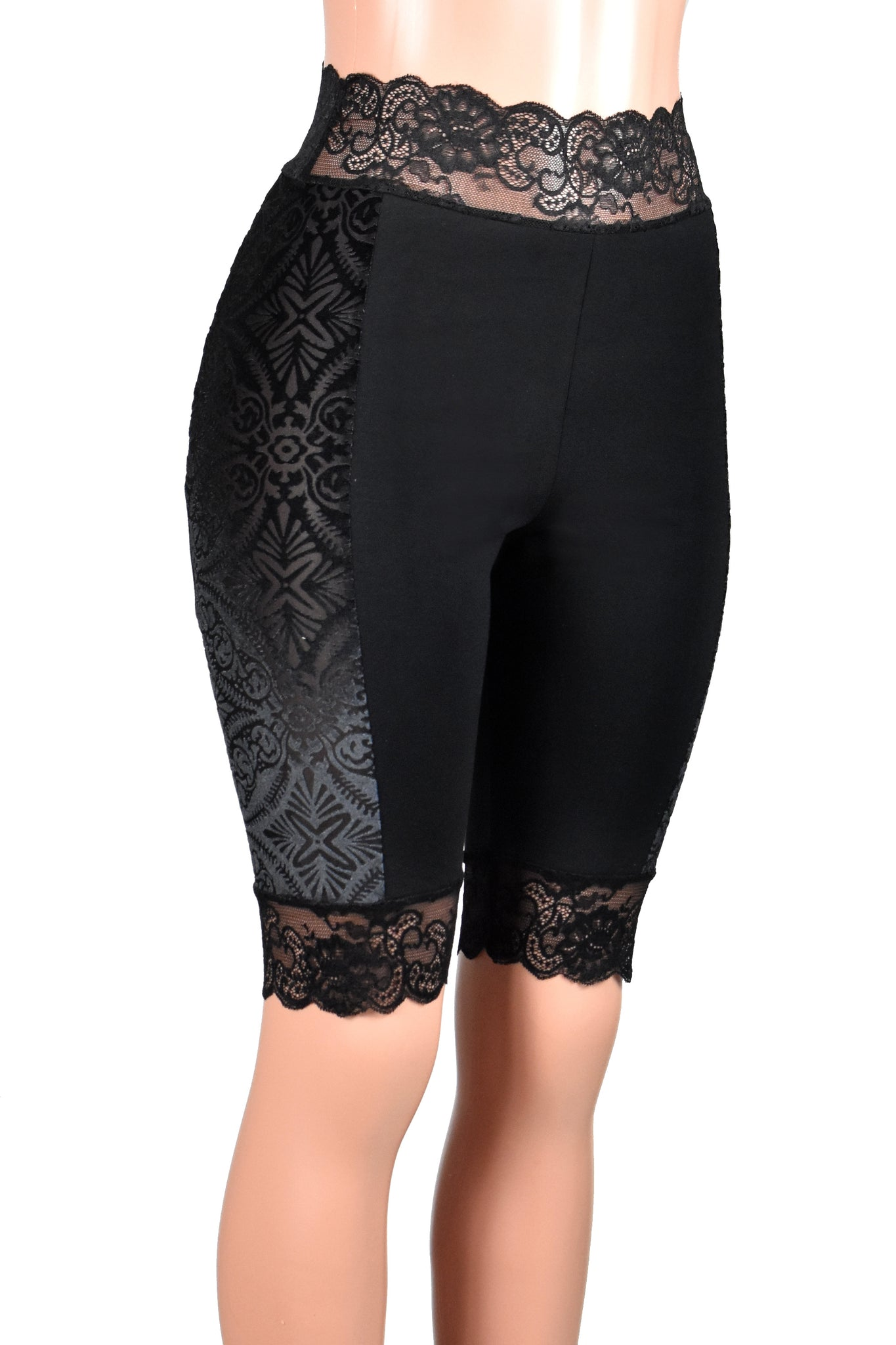 These black high-waisted knee length shorts have a stretch lace waistband. The side panels are made out of sheer brocade velvet burnout stretch fabric. Wear them under skirts, dresses, or shorts for extra leg coverage.