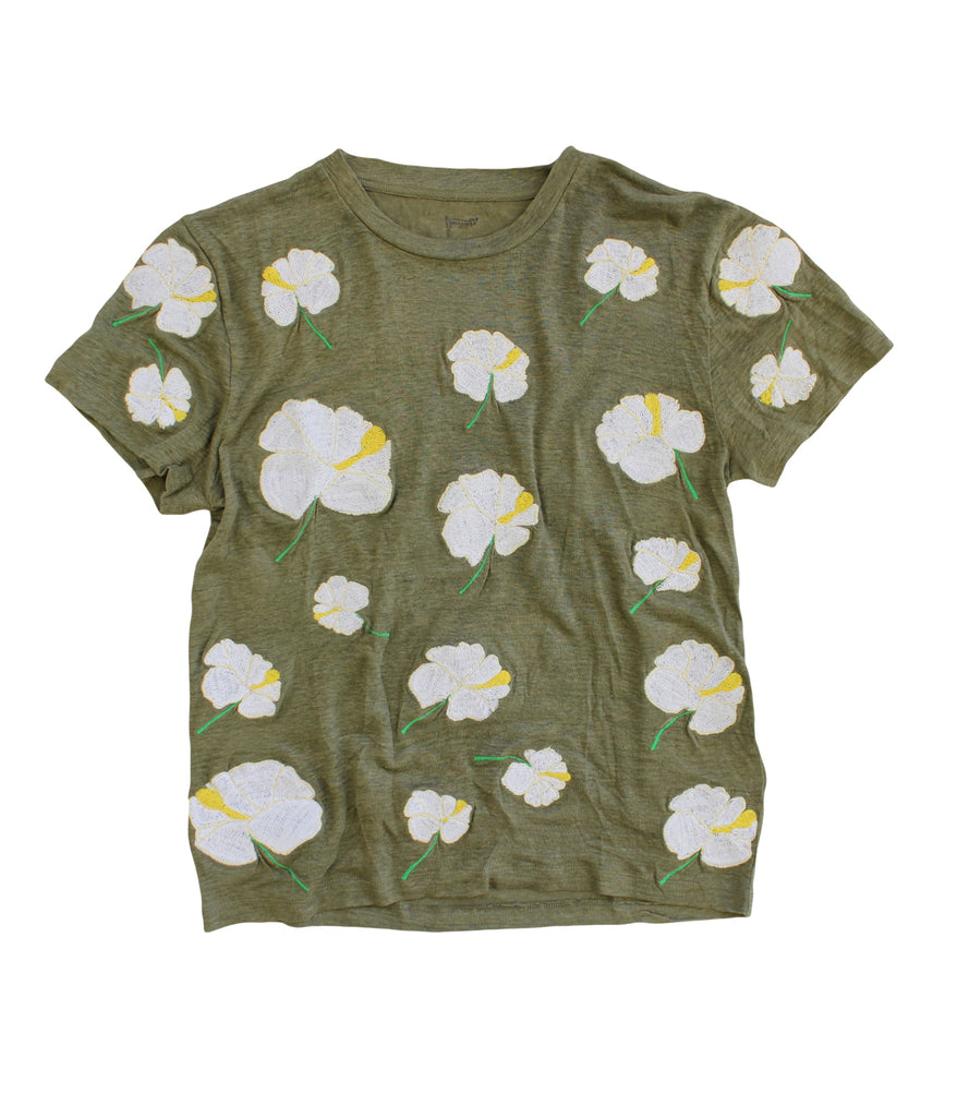embroidered linen tee with white hibiscus flowers on an army green shirt