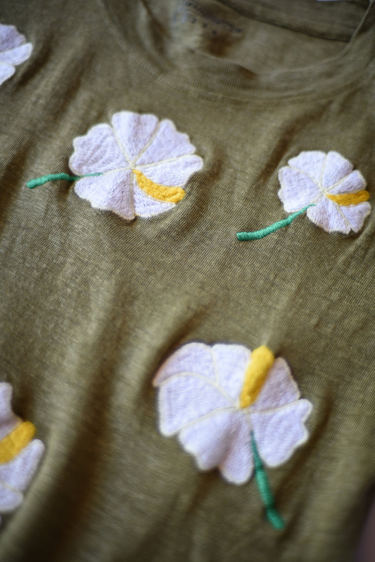 embroidered linen tee shirt with white hibiscus flowers on an army green shirt