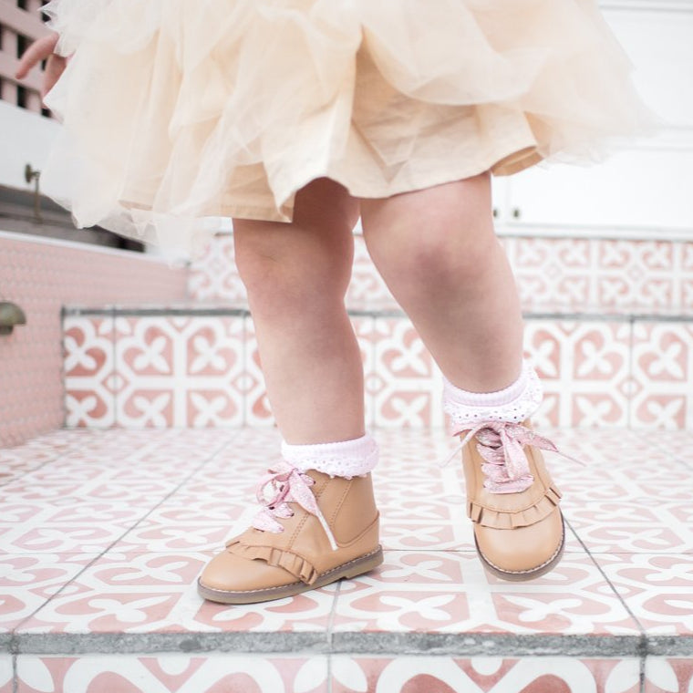 Kids tan boots with pink shoelaces and white frill socks from Sadie Baby