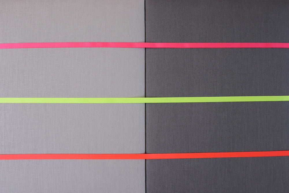 Grey linen fabric notice board with coloured ribbon from Handcrafted by Harriet